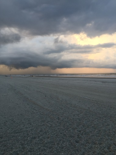 A storm blowing through. Check out the rain pattern in the sand.